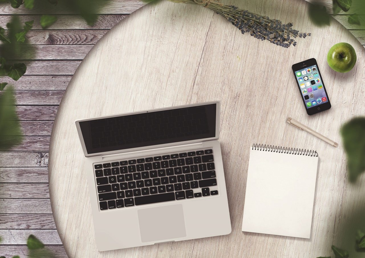 Notepad, Laptop, Phone on the table